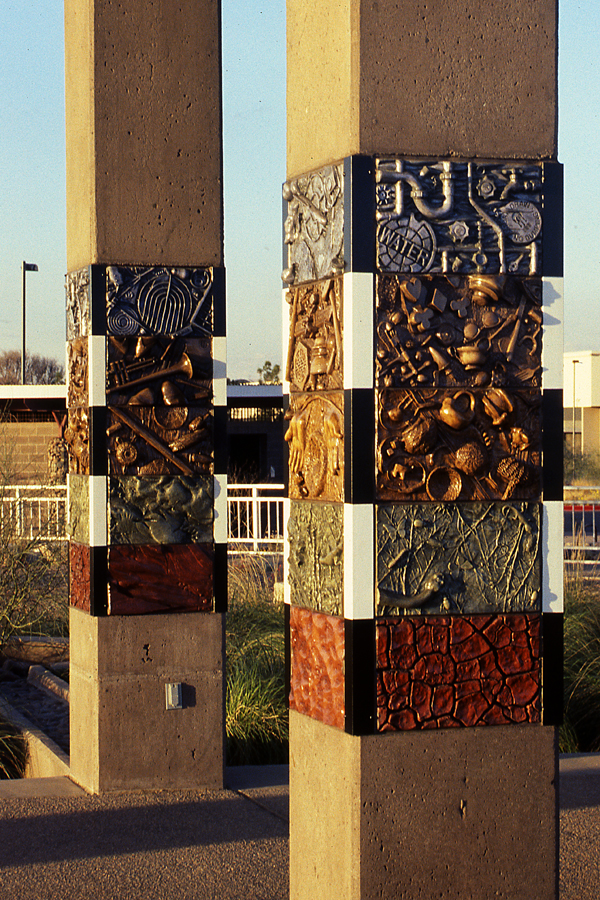 Photograph of two Layers of Time columns showcasing the cast concrete tiles